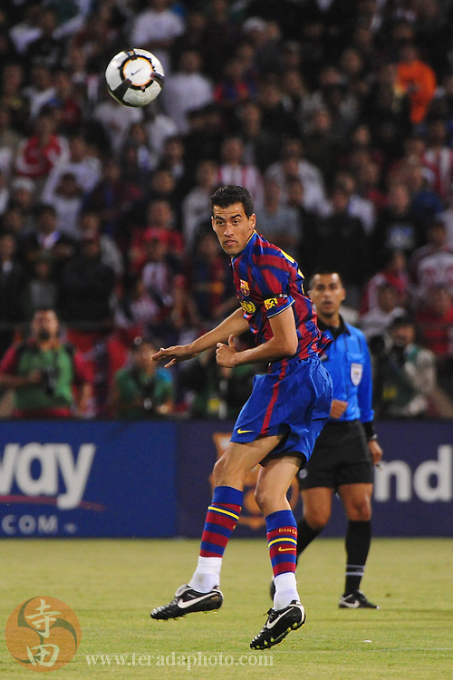 August 8, 2009; San Francisco, CA, USA; FC Barcelona midfielder Sergi Busquets (16) heads the ball during the second half in the Night of Champions international friendly contest against Chivas de Guadalajara at Candlestick Park. The game ended in a 1-1 tie.