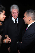 l to r: New York State First Lady Michelle Paige Patterson, Former President Bill Clinton and Governor David Patterson at The Amsterdam News 100th Anniversary Gala held at the David H. Koch Theater at Lincoln Center on November 30, 2009 in New York City. © Terrance Jennings / Retna Ltd.