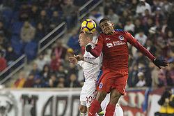 March 1, 2018 - Harrison, New Jersey, United States - New York Red Bulls defender MARC RZATKOWSKI (90) heads the ball away from Club Deportivo Olimpia Midfielder CARLOS WILL MEJêA (7) during the CONCACAF Champions league match at Red Bull Arena in Harrison, NJ.  NY Red Bulls defeat CD Olimpia 2-0  (Credit Image: © Mark Smith via ZUMA Wire)