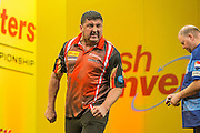 Mensur Suljovic celebrates winning a leg during the Cash Converters Players Championship Final at Butlins, Minehead, United Kingdom on 25 November 2016. Photo by Shane Healey.