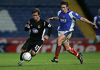 Photo: Lee Earle.<br /> Portsmouth v Wigan Athletic. The FA Cup. 06/01/2007. Wigan's Kristoff Haestad (L) sprints away from Sean Davis.