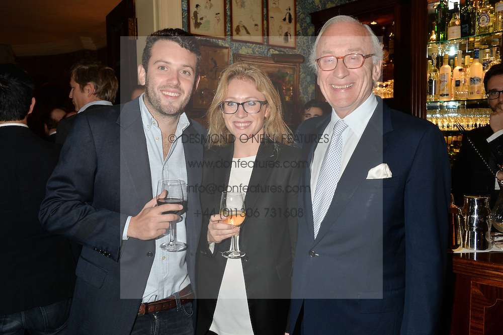 Left to right, JAMES GUMMER, NAOMI ALLSOPP and their father LORD CHADLINGTON at a party to celebrate the publication of Right or Wrong: The Memoirs of Lord Bell held at Mark's Club, Charles Street, London on 16th October 2014.