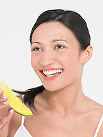 Young Woman Eating Honeydew Melon close up