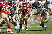 SAN FRANCISCO - SEPTEMBER 17:  Kick returner Maurice Hicks #43 of the San Francisco 49ers runs through a pack of defenders while avoiding a tackle by Dane Looker #89 of the St. Louis Rams at Monster Park on September 17, 2006 in San Francisco, California. The Niners defeated the Rams 20-13. ©Paul Anthony Spinelli *** Local Caption *** Maurice Hicks;Dane Looker