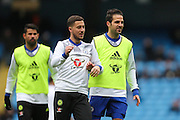 Chelsea's Eden Hazard and Cesc Fabregas warm up before the Premier League match between Manchester City and Chelsea at the Etihad Stadium, Manchester, England on 3 December 2016. Photo by Simon Brady.