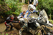 Bill Dragoo and Brad ? push from behind while Jim Stoddard pulls from the front and Briene Thompson rides an R1200GS out of a creek bed at the BMW GS Trophy Ch