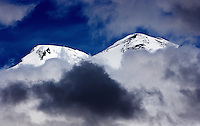 Russia, Caucasus, Mount Elbrus surrounded by clouds. Europes highest mountain. 5642 m asl.