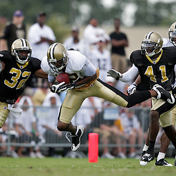 04 August 2009: New Orleans Saints wide receiver Marques Colston (12) makes a reception between defenders Jabari Greet (32) and Roman Harper (41) during New Orleans Saints training camp at the team's practice facility in Metairie, Louisiana.