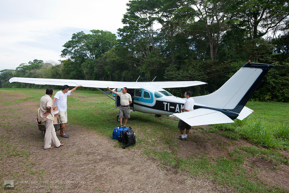 Park Ranger and Pilot Talking After Air Delivery of Supplies to Sirena Biological Station in Corcovado National Park, Costa Rica