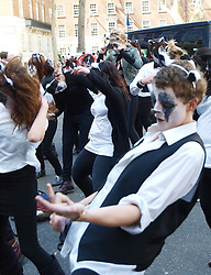 Flashmob activists dance during a demonstration outside the London offices of the Department for Environment, Food, and Rural Affairs against the cull of badgers in Britain , Wednesday May 1, 2013. Photo by: Max Nash / i-Images