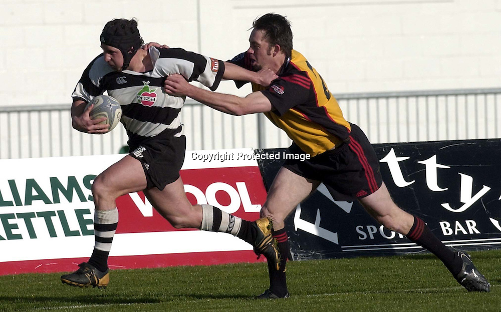 Hawkes Bay no 9 Chad Shepherd fends a tackle during the NPC second Division clash between Hawkes Bay and Thames Valley played at McLean Park, Napier, New Zealand, today, 21 August 2004. Hawkes Bay won the match 88-0<br /> Photo: Photosport