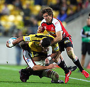 Hurricanes Faifili Levave offloads as he gets wrapped up by the Lions defense. Investec Super 15 rugby match - Hurricanes v Lions, at Westpac Stadium, Wellington, New Zealand on Saturday 4 June 2011. Photo: Justin Arthur / photosport.co.nz