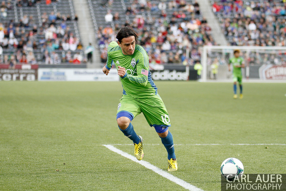 April 20th, 2013 Commerce City, CO - Seattle Sounders FC midfielder Mauro Rosales (10) chases down the ball in the second half of action during the MLS match between the Seattle Sounders FC and the Colorado Rapids at Dick's Sporting Goods Park in Commerce City, CO