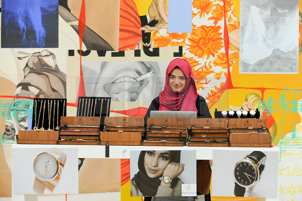 © Licensed to London News Pictures. 18/02/2017. London, UK.   A retailer presents watches for sale at the UK's first London Modest Fashion Week taking place this weekend at the Saatchi Gallery.  The two day event sees 40 brands from across the world come together to showcase their collections for Muslim and other religious women. Photo credit : Stephen Chung/LNP
