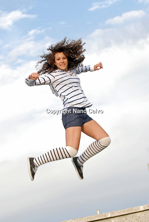 Cute teen jumps high
