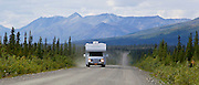 Alaska. Summer scenic view of an RV coming down the Denali Highway, near the Nenana River.