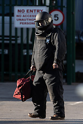© Licensed to London News Pictures . 14/05/2020. Manchester, UK.  An member of the bomb disposal team dons protective clothing and walks to where the suspicious item is located at an industrial unit . Police, fire and The Royal Logistics Corps respond to a scene in Trafford Park. Greater Manchester Police say that, whilst searching a vehicle seized yesterday evening (13th May 2020) in Salford as part of an investigation in to drugs, a suspicious device was discovered . Photo credit: Joel Goodman/LNP