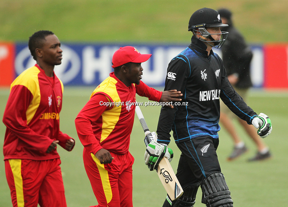 Martin Guptill of the Black Caps dismissed soon after reaching a century is congratulated by Zimbabwean players during the ICC Cricket World Cup warm up game between the Black Caps v Zimbabwe at Bert Sutcjliffe Oval, Lincoln, Christchurch. 9 February 2015 Photo: Joseph Johnson / www.photosport.co.nz