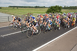 The peloton rides at a casual pace just a few kilometres after the start the Aviva Women's Tour 2016 - Stage 1. A 138.5 km road race from Southwold to Norwich, UK on June 15th 2016.