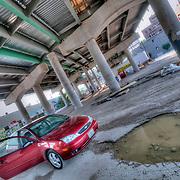 My car underneath a bridge for Interstate 35 in Kansas City, Missouri.