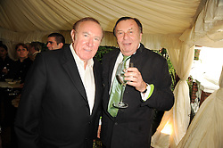 Left to right, ANDREW NEIL and BARRY HUMPHRIES at the Apollo Magazine Summer Party held at 22 Old Queen Street, London, SW1 on 29th June 2010.