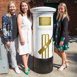 Head of Marketing for the ECB Claire Jackson, left, Jenny Smith, Head of Communications for the ECB and Royal Mail Senior PR Campaigns Manager Jasmine Prichard pose with the white-painted postbox as Royal Mail unveils a postbox outside Lords Cricket Ground with a plaque and graphics that celebrate England's ICC Cricket World Cup Victory. London, July 16 2019.