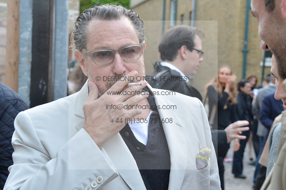 JULIAN SCHNABEL at a private view in aid of Chickenshed of Julian Schnabel's first UK solo show of paintings for 15 years entitled 'Every Angel Has A Dark Side' held at the Dairy Art Centre, 7a Wakefield Street, Bloomsbury, London on 24th April 2014.