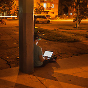 Cubans gather with their laptops or smart phones in Wi-Fi hot spots day or night, mostly in neighborhood parks where locals congregate to surf the internet, make face time calls or check their out Facebook and email accounts. Photography by Jose More