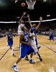 Virginia forward/center Jerome Meyinsse (55) shoots against Hampton.  The Virginia Cavaliers men's basketball team defeated the Hampton Pirates 79-65 at the John Paul Jones Arena in Charlottesville, VA on December 19, 2007.