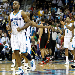March 30, 2011; New Orleans, LA, USA; New Orleans Hornets power forward Carl Landry (24) reacts after making a pair of free throws to extend the lead over the Portland Trail Blazers in the fourth quarter at the New Orleans Arena. The Hornets defeated the Trail Blazers 95-91.   Mandatory Credit: Derick E. Hingle