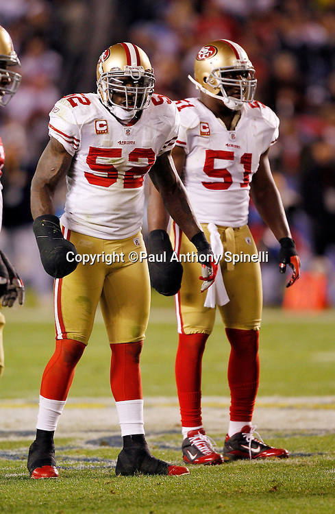 San Francisco 49ers linebacker Patrick Willis (52) and Francisco 49ers linebacker Takeo Spikes (51) have both of their right hands wrapped and taped to look like black clubs during the NFL week 15 football game against the San Diego Chargers on Thursday, December 16, 2010 in San Diego, California. The Chargers won the game 34-7. (©Paul Anthony Spinelli)