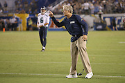 Seattle Seahawks head coach Pete Carroll points and screams at officials after a penalty is called on his team on their game winning fourth quarter drive while dragging his communication headsets behind him during the 2015 NFL preseason football game against the San Diego Chargers on Saturday, Aug. 29, 2015 in San Diego. The Seahawks won the game 16-15. (©Paul Anthony Spinelli)