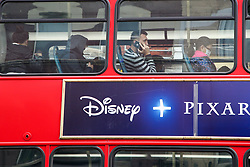 © Licensed to London News Pictures. 20/06/2020. London, UK. Commuters with and without face coverings travel on a bus in north London. Face coverings are now compulsory on buses, trains, trams and planes. Secretary of State for Transport, Grant Shapps has said that, people who do not wear face coverings on public transport could be fined up to £100. Photo credit: Dinendra Haria/LNP