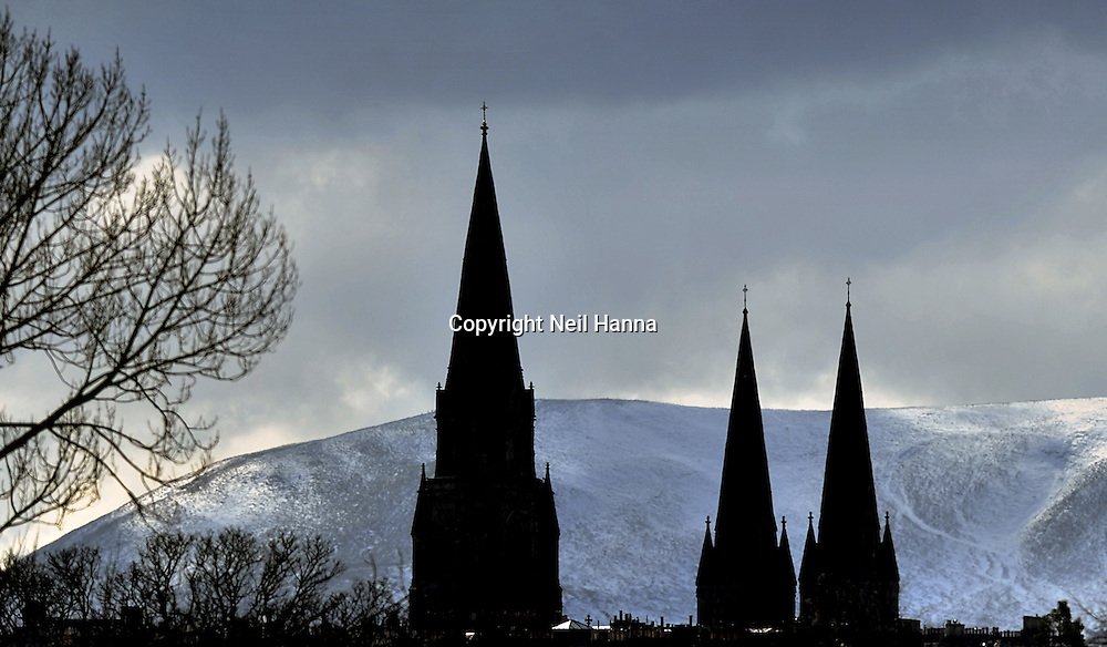 St Mary's Cathedral silhouetted against the Pentland Hills. First published in Evening News<br /> Pic Neil Hanna