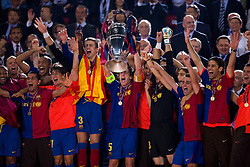 ROME, ITALY - Tuesday, May 26, 2009: Barcelona's captain Carles Puyol lifts the Euopean Cup after beating Manchester United 2-0 during the UEFA Champions League Final at the Stadio Olimpico. (Pic by Carlo Baroncini/Propaganda)