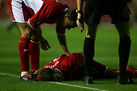 Photo: Andrew Unwin.<br />Middlesbrough v Dnipro. UEFA Cup. 03/11/2005.<br />Middlesbrough's Szilard Nemeth (L) comes to check on his team-mate, Stuart Parnarby (C), as he lies injured.