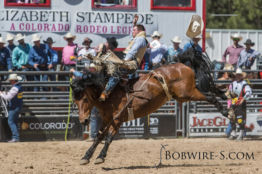 Tanner Burgener takes a reride on a bareback bronc during the first performance at the Elizabeth Stampede on Saturday, June 2, 2018.