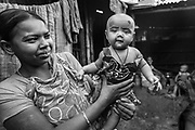 A mother and duaghter at their home in a slum area in Bangladesh.