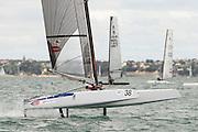 Glenn Ashby (AUS111) foils to a first in race one of the A Class World championships regatta being sailed at Takapuna in Auckland. 11/2/2014