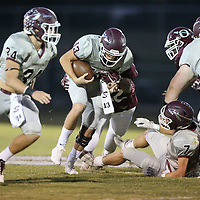 Smithville quarterback Cameron Wardlaw tries to pick up the first down against Okolona in the first quarter on Friday.