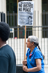 """Zimmerman's trial began on June 10, 2013, in Sanford. On July 13, 2013, he was found not guilty of second-degree murder and of manslaughter charges of Trayvon Martin.<br /> Demonstrator holds a placard reading """"No justice No Peace, Remember Trayvon Martin""""  outside the American Embassy to protest the recent Trayvon Martin's Verdict,<br /> London, United Kingdom<br /> Tuesday, 16 July 2013<br /> Picture by Piero Cruciatti / i-Images"""