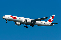 Boeing 777-3DE ER (HB-JNC) operated by Swiss on approach to San Francisco International Airport (KSFO), San Francisco, California, United States of America
