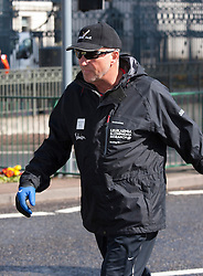 """© Licensed to London News Pictures.17/04/2012. Birmingham UK. Ian """"Beefy"""" Botham starts the  Birmingham leg of his """"Great Forget Me Not Walks"""" to raise money for Leukaemia & Lymphoma Research. On hand to give support were tennis ace Tim Henman and Coventry City footballer Carl Baker whose older brother died of Leukaemia and his younger brother is under going treatment for the same condition. Pictured, Ian """"Beefy"""" Botham sets off on his walk with Tim Henman along Broad Street in Birmingham. Photo credit : Dave Warren/LNP."""
