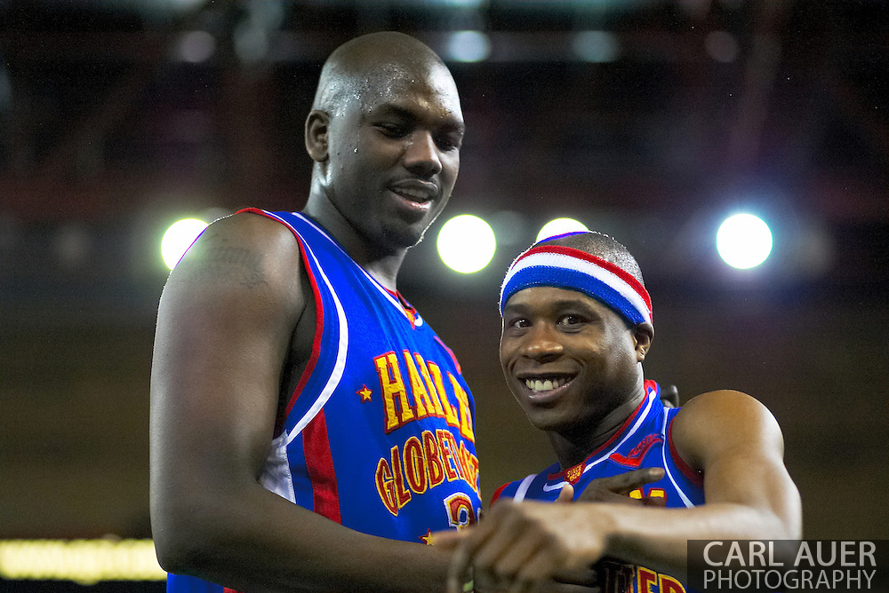 04 May 2006: Keiron 'Sweet P' Shine and Nate Lofton ham it up for the camera during the Harlem Globetrotters vs the New York Nationals at the Sulivan Arena in Anchorage Alaska during their 80th Anniversary World Tour.  This is the first time in 10 years that the Trotters have visited Alaska.