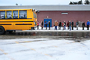 Primary day in New Hampshire, Hampstead voters wait in line outside of the Middle School to for the polls to open Tuesday, Feb. 9, 2016.  CREDIT: Cheryl Senter for The New York Times