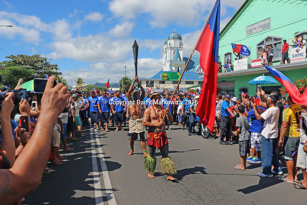 Manu Samoa proudly paraded by foot , cheered on by thousands, from the Apia Fire Station to the Apia Clock Tower while the NZ All Blacks road a bus on Beach Rd., Apia, Upolu, Samoa.  Photo by Barry Markowitz, 7/7/15