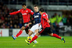 Man Utd Defender Jonny Evans (NIR) is tackled by Cardiff Midfielder Gary Medel (CHI) and Forward Fraizer Campbell (ENG) during the first half of the match - Photo mandatory by-line: Rogan Thomson/JMP - Tel: Mobile: 07966 386802 - 24/11/2013 - SPORT - FOOTBALL - Cardiff City Stadium - Cardiff City v Manchester United - Barclays Premier League.