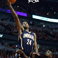 CHICAGO, IL - APR 18: Paul George #24 of the Indiana Pacers shoots the ball against Luol Deng #9 of the Chicago Bulls during game 2 of the Eastern Conference First Round at the United Center on April 18, 2011 in Chicago, IL. NOTE TO USER: User expressly acknowledges and agrees that, by downloading and or using this photograph, User is consenting to the terms and conditions of the Getty Images License Agreement. Mandatory Credit: 2011 NBAE (Photo by Chris Elise/NBAE via Getty Images)