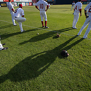 Players and their shadows on the field before the start of the Vancouver Canadians home opener against the Spokane Indians at Nat Bailey Stadium.