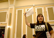 Gender and Equity in Society group leader Isabel Vervoordt looks for members of her group during the Learning Communities meeting Sunday evening in the Baker Hall Ballroom.